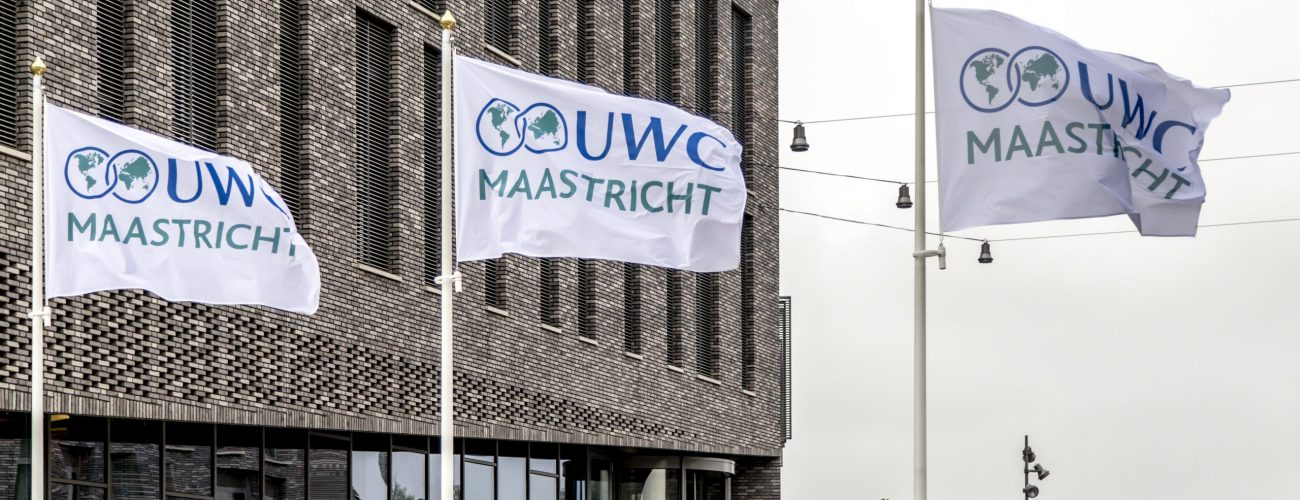 UWC Flags in front of school building