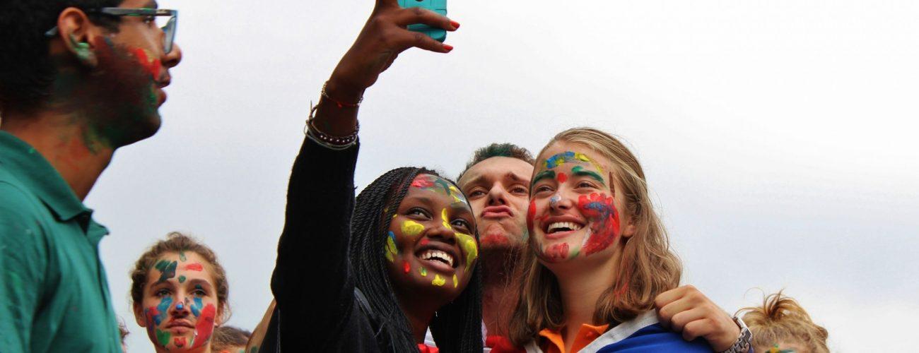 Students making selfie together